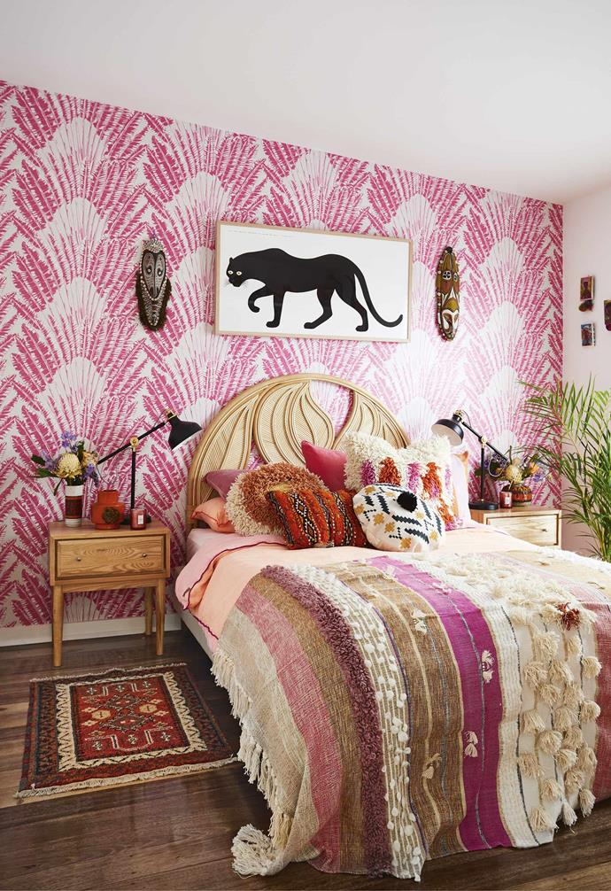 """**Master bedroom** Kingdom Home's 'Feather Palm' wallpaper is a vibrant backdrop to a 'Palm Springs' bedhead from [The Family Love Tree](https://www.thefamilylovetree.com.au/