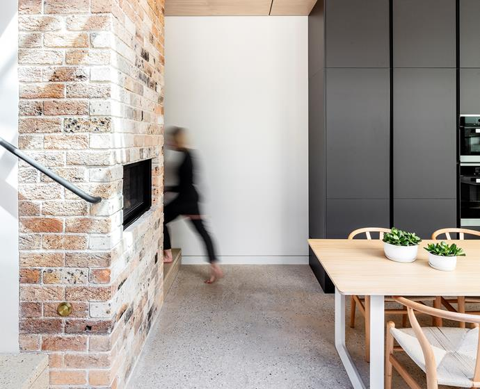 Modern plaster was removed to reveal the original chimney brickwork. The Lopi gas fire was selected for its ability to connect to the home automation system.