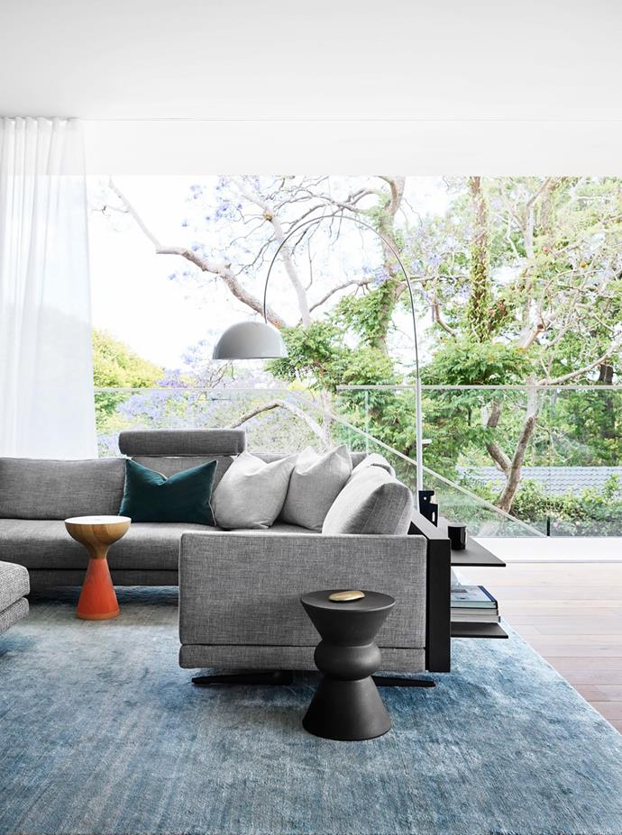 Family Rooms at the rear of the house are designed to enhance integration with the adjacent 4m-deep verandah and garden. Mondrian modular sofa, Space. Abrash Solid rug, Cadrys. Float side table (left), Spence & Lyda. Chess side stool, Robert Plumb.