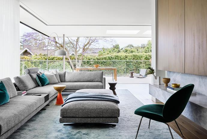 Mondrian modular sofa and matching ottoman, Space. Angel floor lamp, Fanuli. Gubi 'Beetle' lounge chair in Velluto Green fabric, Cult. Abrash Solid rug, Cadrys. Curtains in Studio Collection 'Sinua' fabric, Tigger Hall Design.