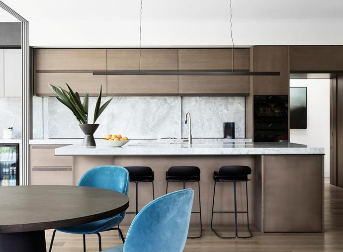 Splashback and benchtop are Liberty Grey dolomite. American oak joinery. BCN kitchen stools, Fanuli. Moooi 'Container' dining table, Space. Beetle dining chairs, Cult. Artwork in hall by Theresa Hunt.