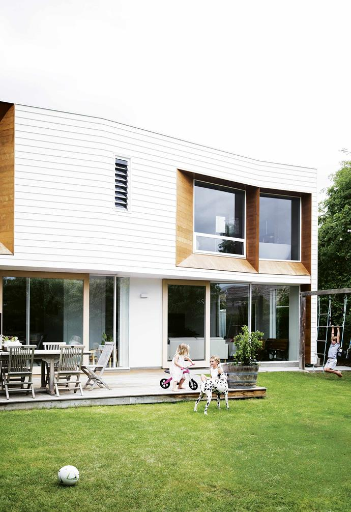 """There were family, friends and the convenience of living in a small city, plus, the beautiful coastline and natural surrounds. But perhaps more than anything, there was an opportunity to create a home just as they wanted it.<br><br>**Exterior** Posy, Jemima and Louis play in the backyard. [Preston Lane Architects](https://prestonlane.com.au/