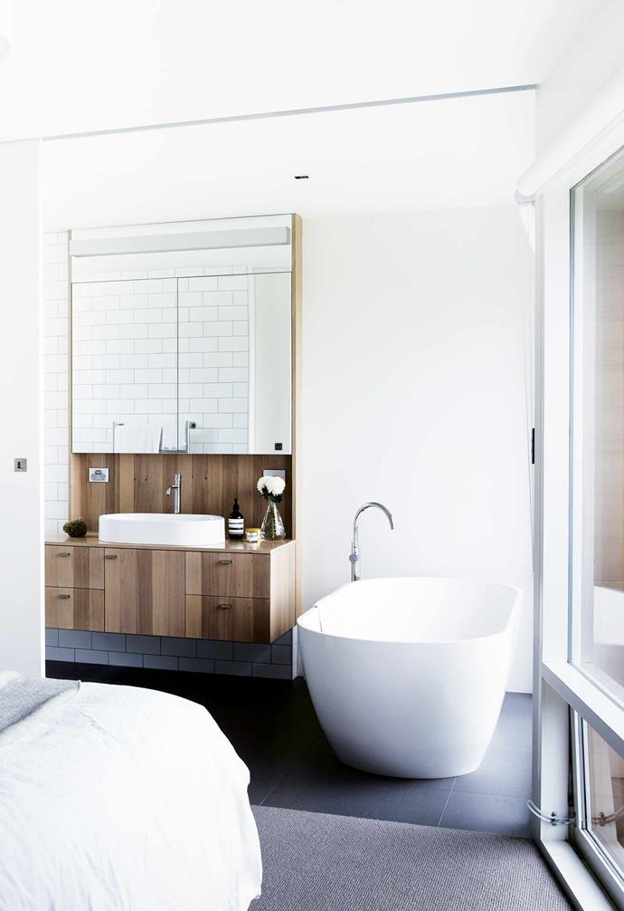 """**Lessons learnt** """"Our biggest mistake was compromising the size of the laundry to gain a butler's pantry,"""" says Sophie. """"But we knew we could reconfigure adjoining rooms down the track if we needed to.""""<br><br>**Ensuite** This luxurious ensuite is separated from the bedroom with a clever sliding door. Clearwater 'Formoso' bath, [Reece](https://www.reece.com.au/