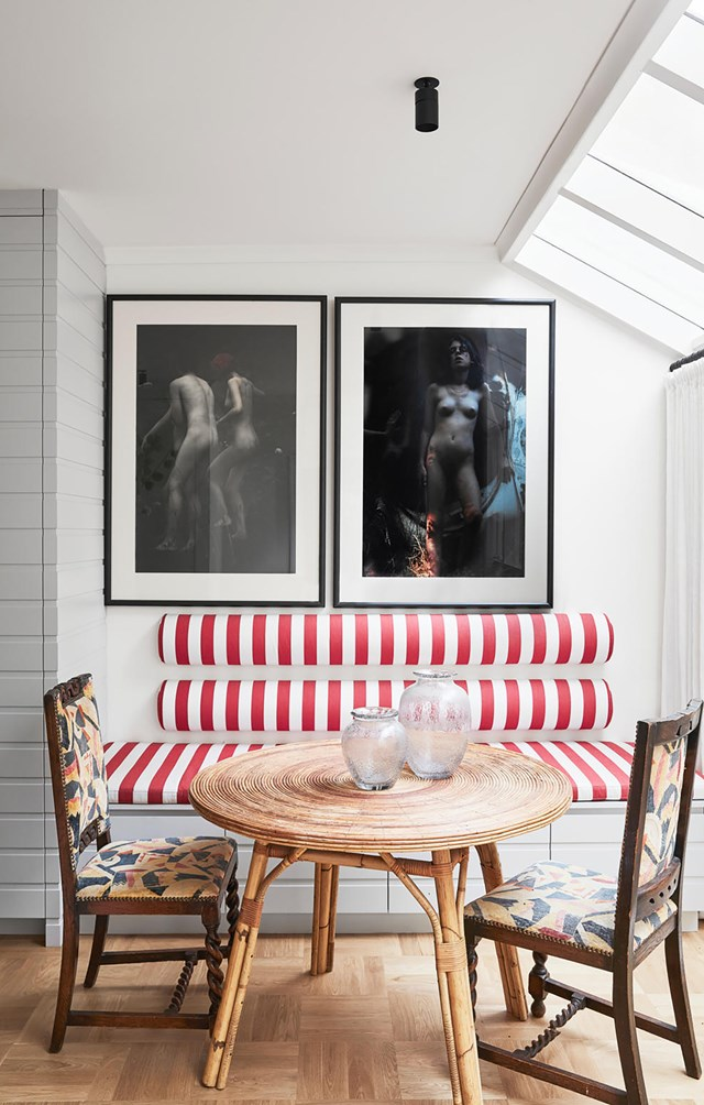 "A custom-designed bench upholstered in Ralph Lauren Home­ fabric anchors a pair of Bill Henson artworks in this cafe-style setting inside a [mid-century home](https://www.homestolove.com.au/revamped-mid-century-family-retreat-21023|target=""_blank"") revamped by interior designer Tasmin Johnson."