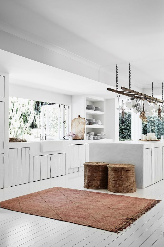 "The kitchen features a plaster finish called Tadelakt. ""I'd seen it on Pinterest and loved it. I showed [design studio] CM Studio, and they found someone who did it – but he'd only ever done a benchtop before, not a whole kitchen and bathrooms! It's an amazing process,"" Romi says."