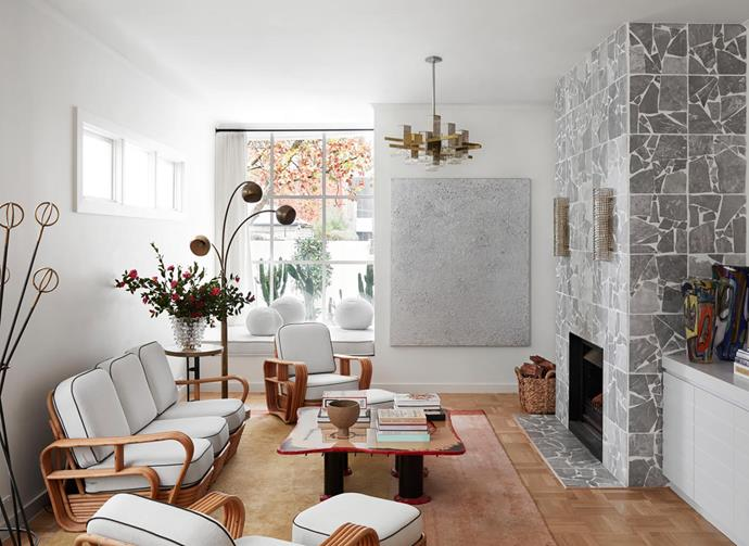 Parquetry floors by Kustom Timber and a custom Palladiana stone tile fireplace. Custom Tamsin Johnson design rug, Gaetano Pesce coffee table. Curtis Jere pendant light from 1stdibs. Artwork by Lane Cormick from Daine Singer, Gio Ponti coat rack. Side table and vase from Edward Clark Antiques.