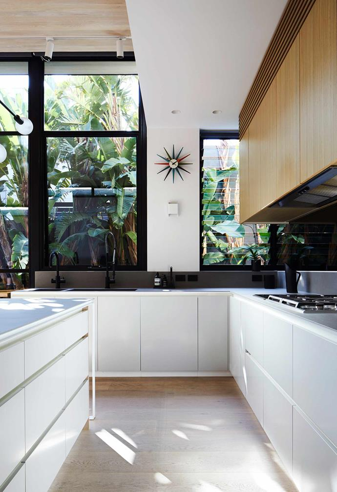 """**Kitchen** There's a generous 1200mm between the island bench and cupboards. All the benchtops are Maximum 'Aster Mercury' porcelain panels from [Artedomus](https://www.artedomus.com/