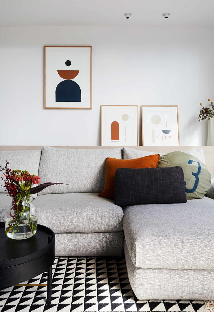 """**Family room** A wall ledge is perfect for art and flowers. The prints are by Bobby Clark. Hudson sofa, [Jardan](https://www.jardan.com.au/