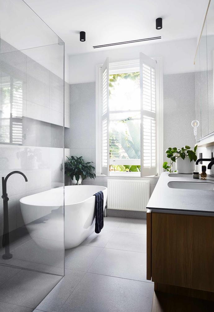 """**Ensuite** Upstairs with glimpses of palms below, this space is fitted with [Fibonacci Stone](https://www.fibonaccistone.com.au/