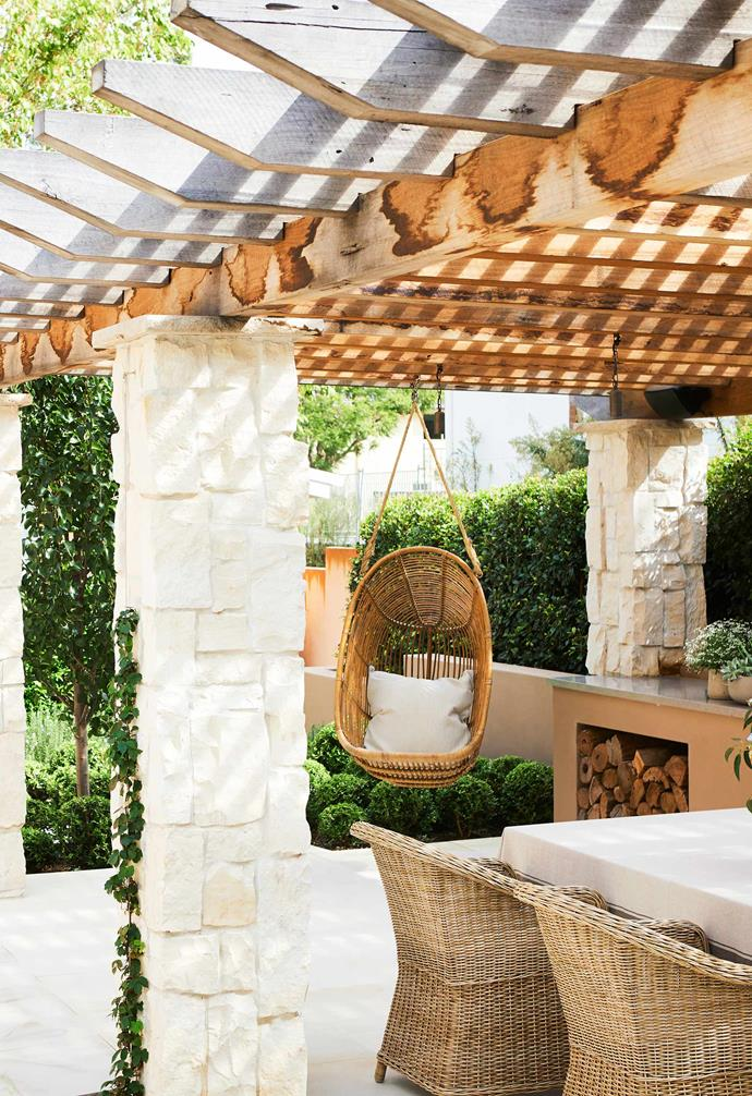 """**Pergola** In the Spanish-inspired design, solid timber beams sit atop piers clad in Newport Random Ashlar stone from [Eco Outdoor](https://www.ecooutdoor.com.au/