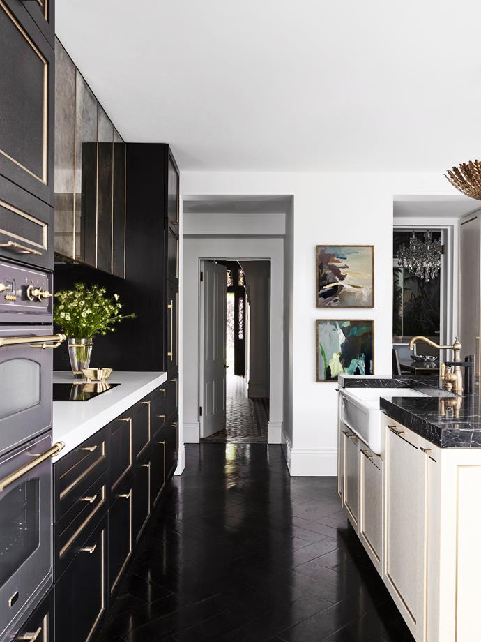 Black cabinetry in Black Tulip veneer with brass inlay. White cabinetry in Tabu 'Erable' birdseye maple veneer, Briggs Veneers. Benchtops in Nero Marquina marble (island) and Caesarstone Pure White.
