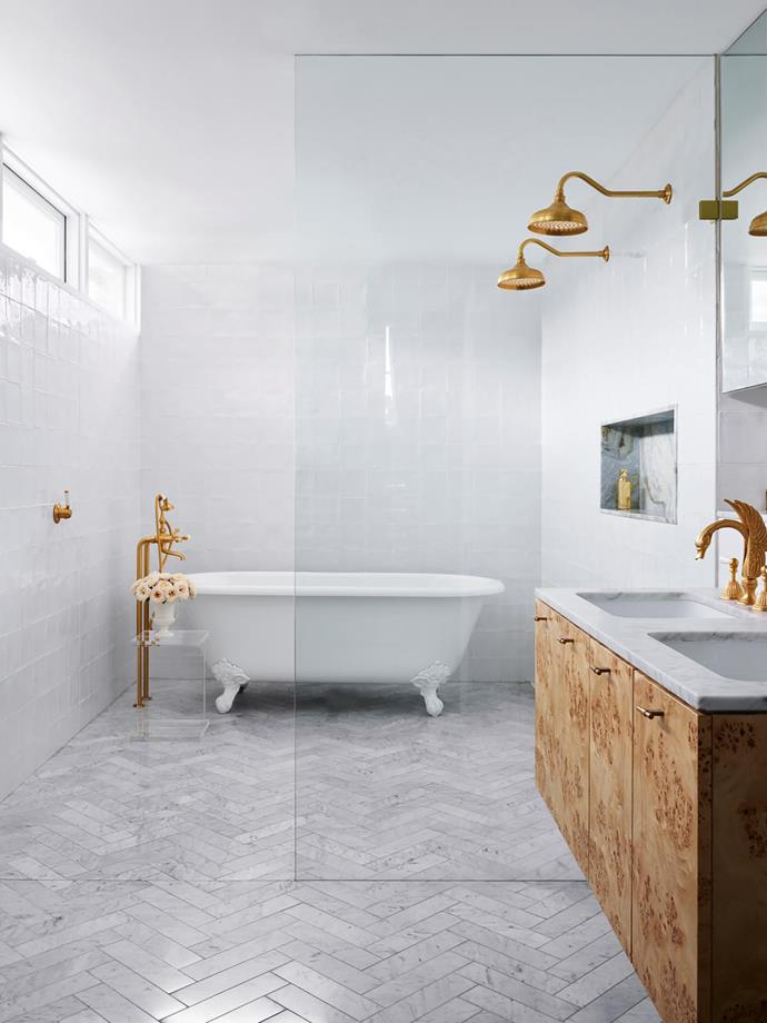 Tapware, all Astra Walker. Gloss white wall tiles and Carrara marble floor tiles, Di Lorenzo Tiles. Niche lined in Blue Wave marble. Vanity in poplar burl veneer from Briggs Veneers. Carrara marble benchtop. Cheshire bath, Victoria+Albert.