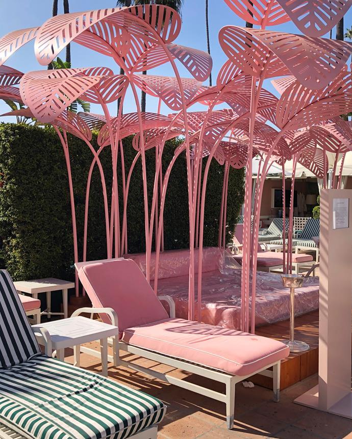 The pool area's newest addition, a pink day bed by artist Marc Ange.