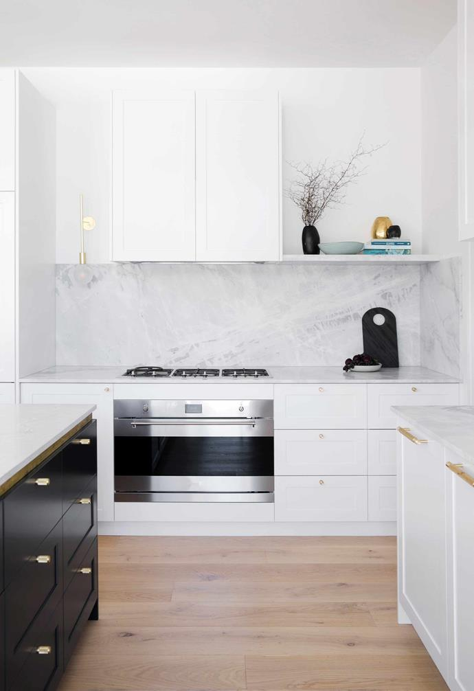 """**Kitchen** The white overhead joinery in two-pack [Porter's Paints](https://www.porterspaints.com/ target=""""_blank"""" rel=""""nofollow"""") K2 contrasts with the island front in [Taubmans](https://www.taubmans.com.au/homeowners target=""""_blank"""" rel=""""nofollow"""") Black Flame."""