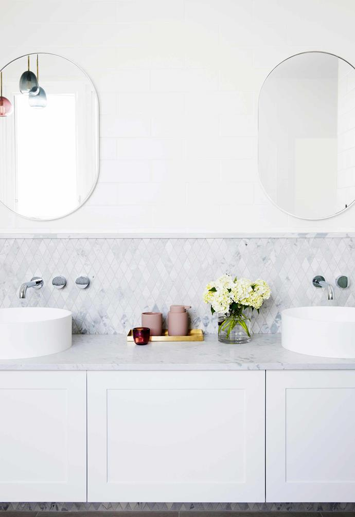 "**Ensuite** Classic subway tiles cover the walls of Deb and Peter's bathroom, while Elba marble tops the vanity and forms the splashback in diamond-shaped tiles from [Artedomus](https://www.artedomus.com/|target=""_blank""