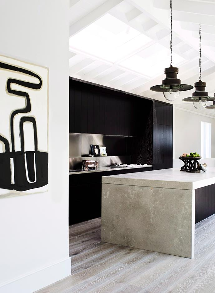 A clever contrast of textures can add depth and dimension to a monochrome kitchen, without diverging from the colour palette. A thoughtfully positioned artwork will add extra personality. *Photo: Prue Ruscoe / Bauersyndication.com.au*