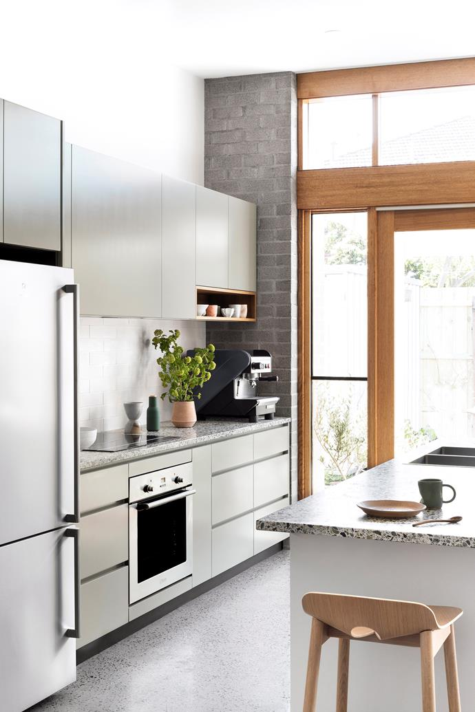 A grey colour scheme in different tones and textures creates a cohesive feel and sense of space in this small kitchen.