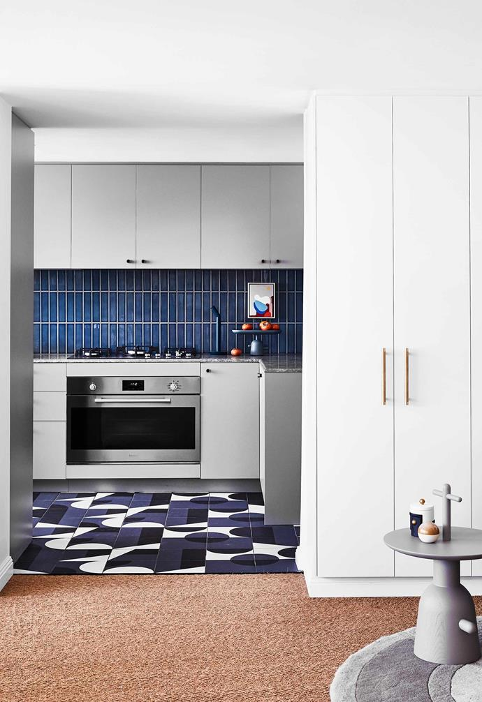 "Sisal carpet was chosen for its sound-proofing qualities throughout this [colourful penthouse apartment](https://www.homestolove.com.au/colourful-penthouse-apartment-with-personality-20466|target=""_blank""), with a vibrant patterned tile making a bold statement in the kitchen space."