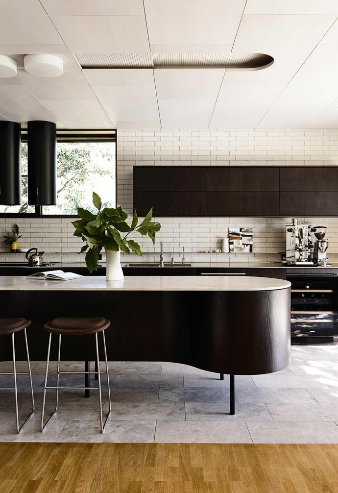 "In architect [Peter Maddison's contemporary home](https://www.homestolove.com.au/inside-architect-peter-maddisons-modernist-home-20475|target=""_blank""), tiles and timber flooring are paired together in the strikingly modern kitchen for a dramatic look."