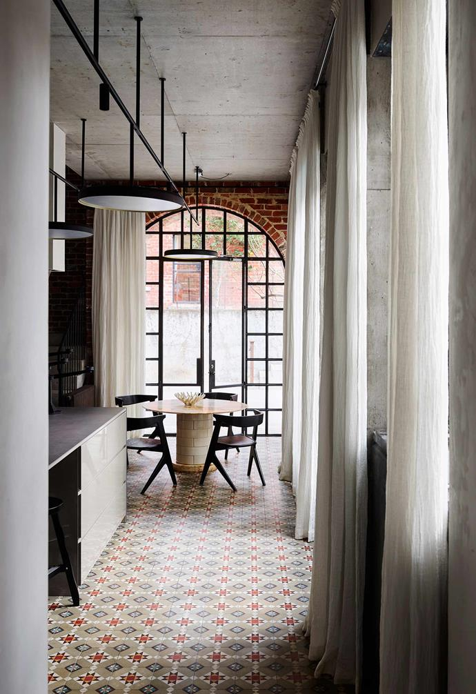 In this Melbourne home the patterned tiles add a playful touch to the industrial-style interior.