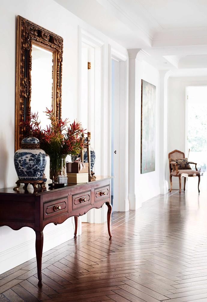 Oak parquetry flooring adds to this European-style apartment's grand aesthetic.