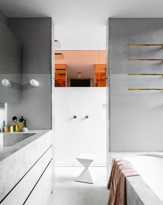 "Luxurious and modern design elements come together in full force in this [sleek ensuite](https://www.homestolove.com.au/honed-grey-marble-and-stone-bathroom-20616|target=""_blank"") designed by Fiona Lynch. It strikes a fine balance between energy and respite, boldness and refinement."