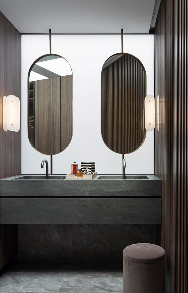 "Nina Maya of Nina Maya Interiors took on the interior architecture and design in the building of her own [split-level contemporary home](https://www.homestolove.com.au/contemporary-home-with-luxe-finishes-20532|target=""_blank"") in Sydney. Luxurious finishes give the moody ensuite boasts a hotel-like appeal."