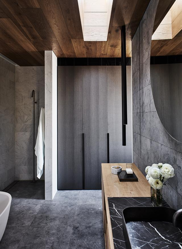 "The ensuite to the master bedroom within Edwina Withers [updated coastal home](https://www.homestolove.com.au/contemporary-coastal-home-sydney-19566|target=""_blank"")  is tonally recessive with a skilful material mix that includes a timber vanity."