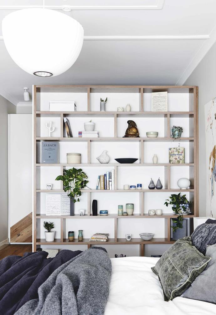 **Master bedroom** Plenty of built-in storage ensures clutter is hidden away, while prized items can be on display. Painting, Pat Hillcoat. Ceramics, Trent Griffiths Ceramics.