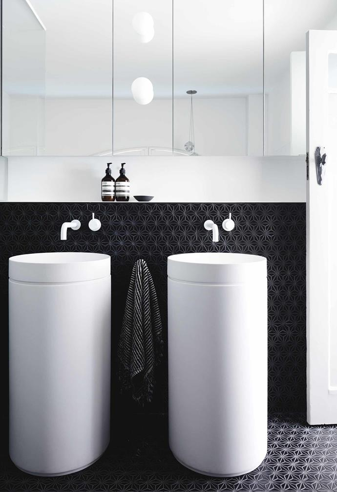 """**Ensuite** A pair of Omvivo 'Mono' basins with pedestals complement the freestanding 'Bliss' spa from [Aqva](https://www.aqva.com.au/