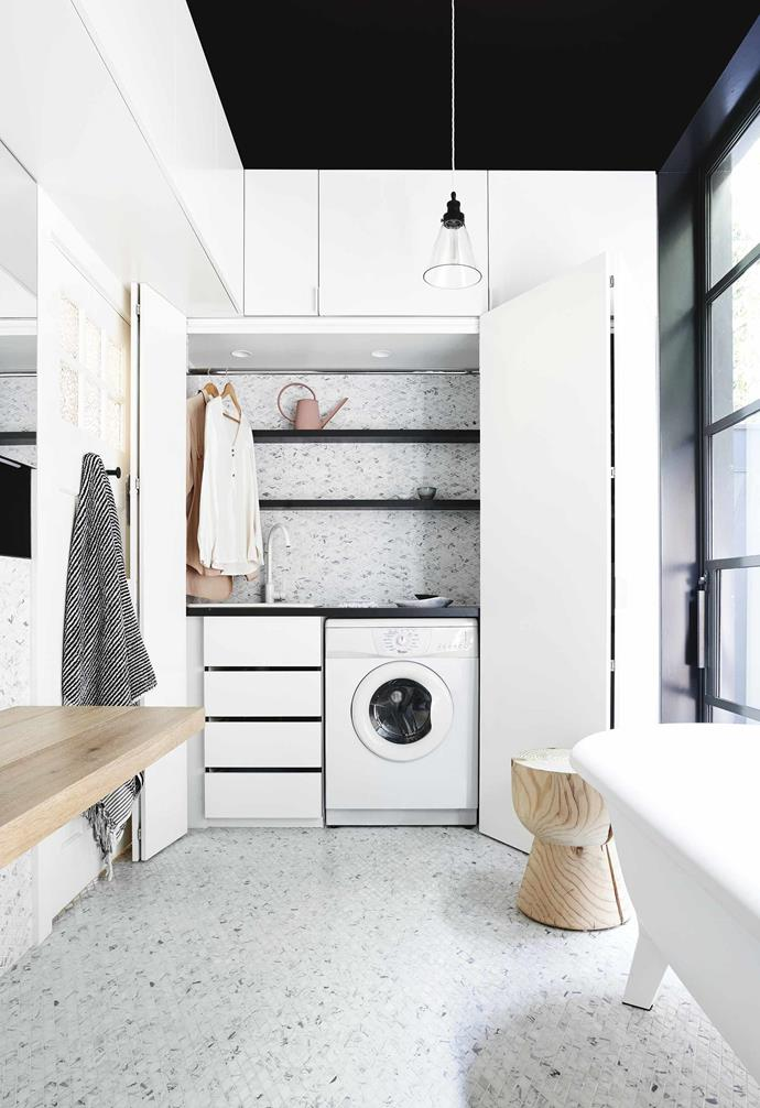"""**Bathroom/laundry** The laundry is hidden behind folding doors, while a sliding glass door opens up to the garden outside. Black-framed window, [Windows on the world](https://www.windowsontheworld.com.au/