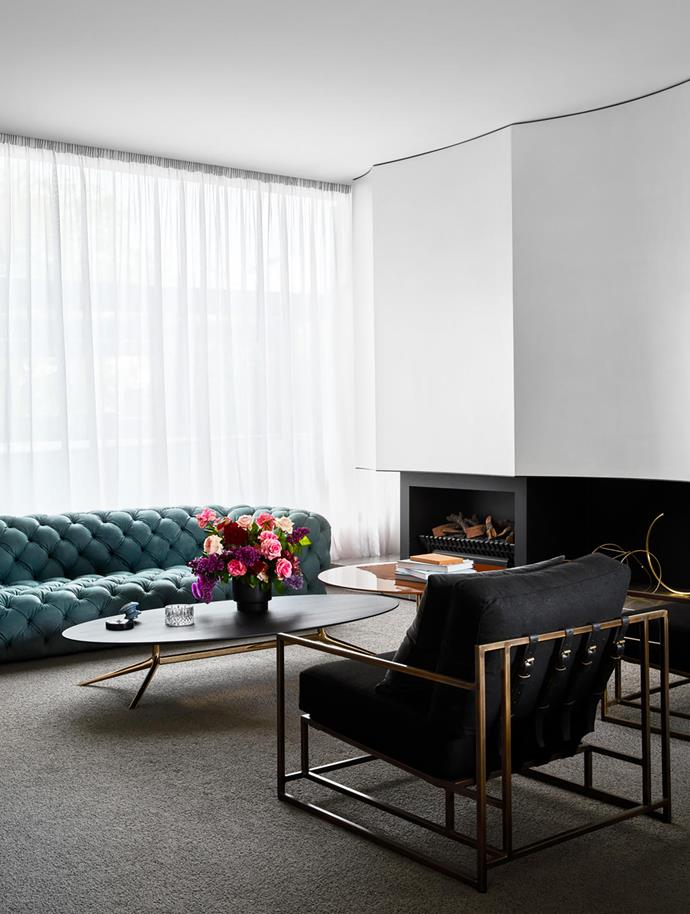 In the formal lounge, a pair of Inheritance Collection armchairs by Stephen Kenn face the Baxter 'Chester Moon' sofa by Paola Navone, all from Criteria. A 'Mondrian' coffee table by Jean-Marie Massaud from Poliform radiates in glossy orange beside the fireplace.
