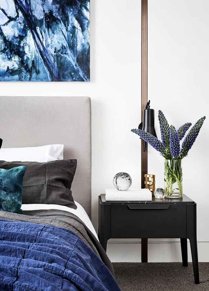 Chinese Whispers II (2015) by Danelle Bergstrom from Arthouse Gallery hangs in the master bedroom. Custom bed by Grazia&Co. Porada 'Ziggy Night' table. 'Silhouette' wall sconce by Ross Gardam.