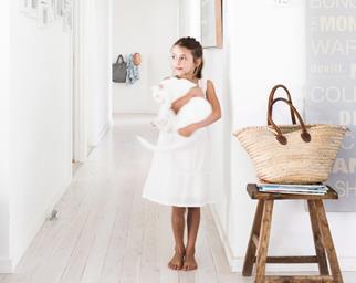 Little girl holding a white cat