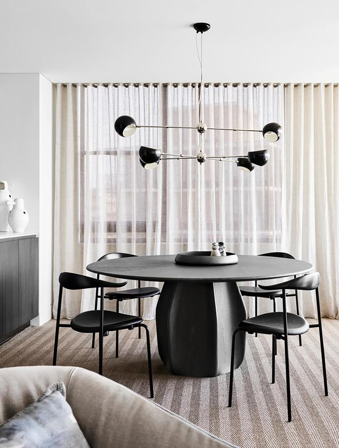 Ringed by Carl Hansen & Søn 'CH88' chairs by Hans J Wegner from Cult, the Molteni&C 'Asterias' dining table by Patricia Urquiola from Hub is characterised by a sculptural base that was inspired by a species of Mexican cactus. An 'Oval Boi' pendant light by David Weeks Studio dazzles above.