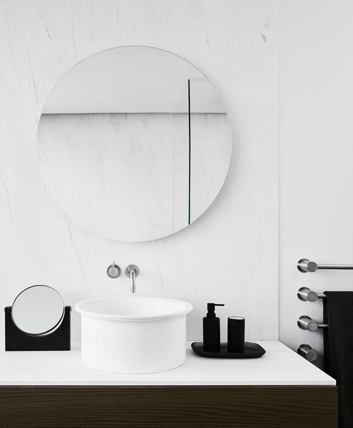 The Agape 'In-Out' basin from Artedomus is fitted with Vola tapware and a back-lit mirror from Bo  with accessories by Oliver Thom from Candana.