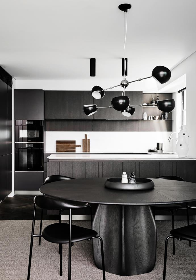 David Weeks Studio 'Oval Boi' pendant light, Molteni&C 'Asterias' dining table by Patricia Urquiola from Hub and Carl Hansen & Søn 'CH88' chairs by Hans J Wegner from Cult.