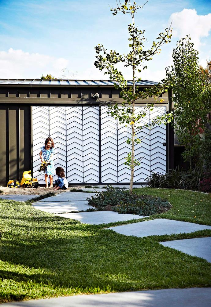 Sheds are often an afterthought — but not this one. Its steel and perspex sliding door with funky chevron pattern makes a real feature of it.