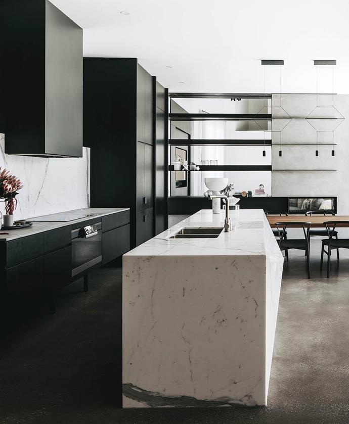Monochrome can be just as striking when done right. If you appreciate a restrained palette, you can add interest to your kitchen by experimenting with interesting finishes, textures and shapes, as with this marble island bench. *Photo: Christopher Morrison*