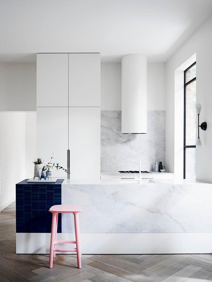 Colour confidence is not necessary for statement-making spaces. The same effect can be made with a single piece of furniture or decor item such as here, where a pink stool shines against the veined marble. *Project design by Lucy Bock Design Studio. Photo: Mark Roper*