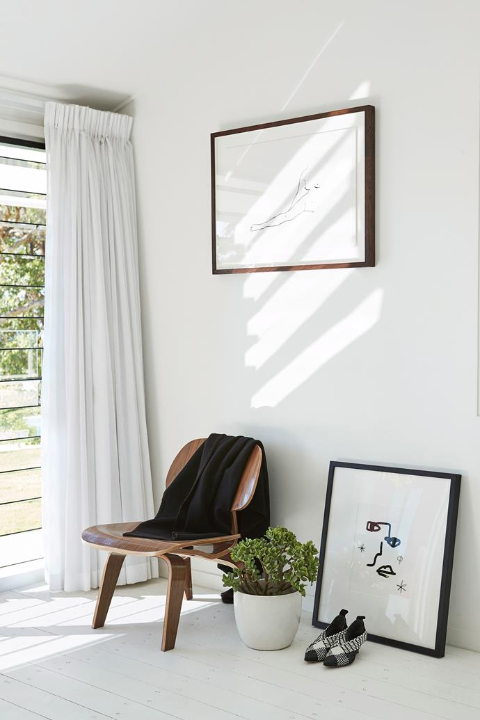 Buy art that suits the style of your home. Here, simple black and white drawings suit the minimalist aesthetic of this room.