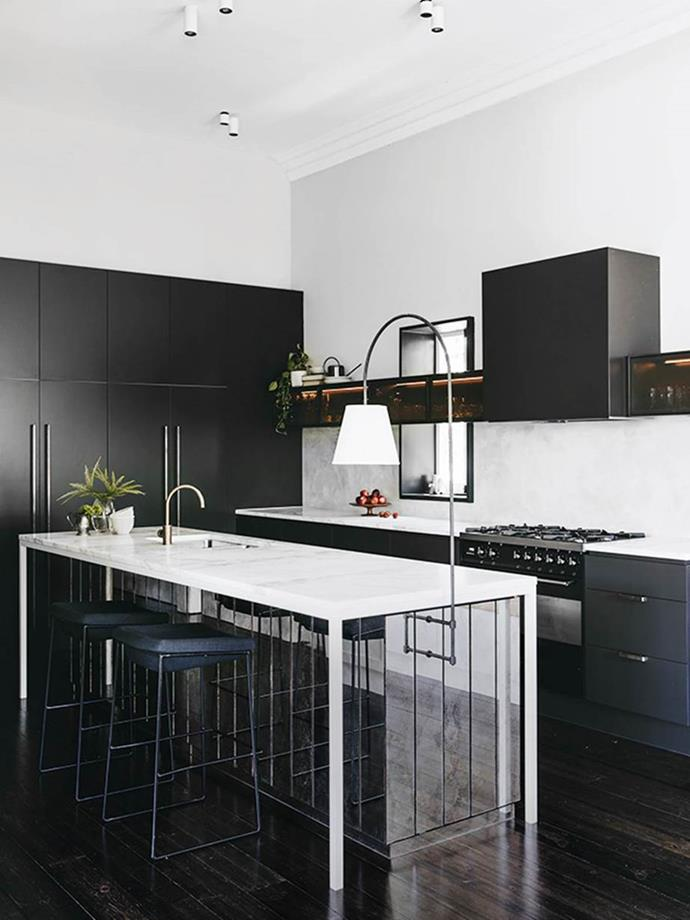 "Contrast and layering transformed this French provincial kitchen into a clean and classic design, featuring antique mirror panels inspired by Coco Chanel's staircase. *Photo: Christopher Morrison / Bauersyndication.com.au* <br><br> *Brought to you by [Liebherr](https://www.liebherr.com/en/aus/start/start-page.html?gclid=CjwKCAiA1L_xBRA2EiwAgcLKAybKitLHatCb-qbaimlrTTHKtj0FTFn6Q4nJN9CLy5xU79csnXlyEBoCHPcQAvD_BwE|target=""_blank""