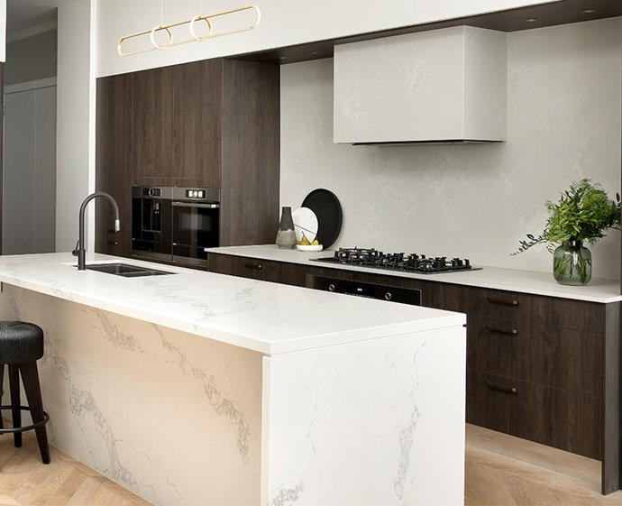 The Chadstone Perugian Walnut cabinetry adds warmth to marble benchtops. *Photo: supplied*