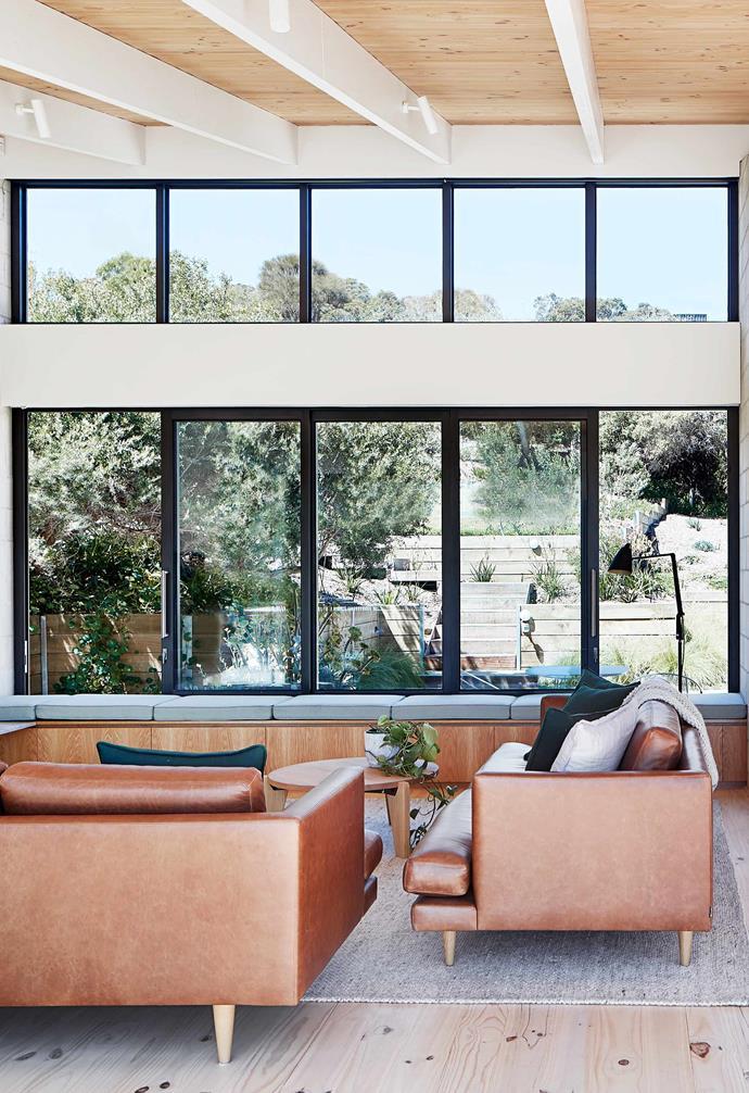 **Upper living** Generous windows capitalise on stunning scenic views.