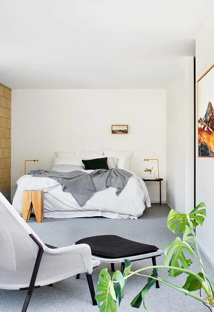 """**Main bedroom** All the bedrooms are functional and stylish. Vitra 'Slow' chair and ottoman, and e15 'ST04 Backenzahn' side table, all [Living Edge](https://livingedge.com.au/