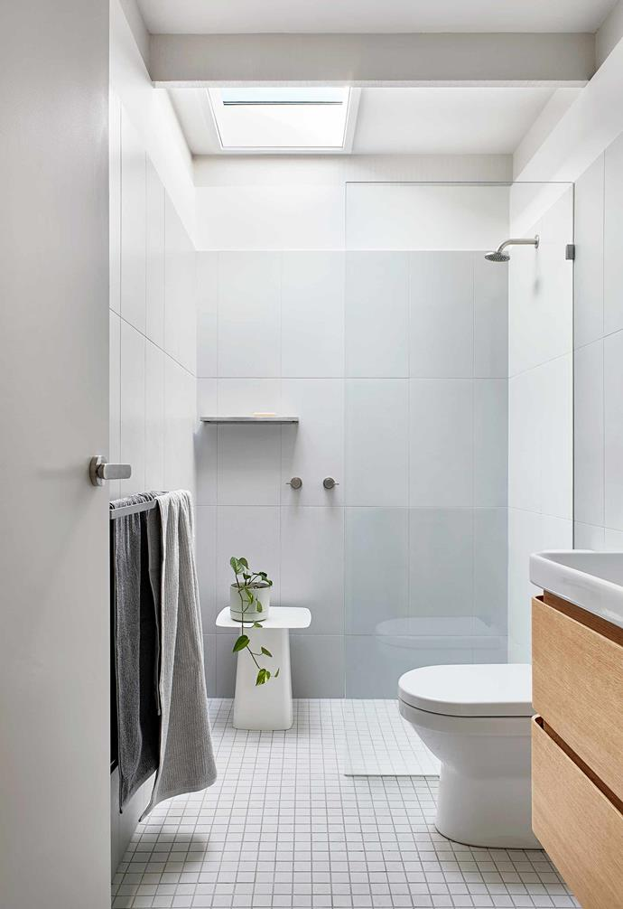 """**Bathroom** A skylight brings natural light to this compact space. Inax Sugie mosaic floor tiles and Nuance wall tiles, [Artedomus](https://www.artedomus.com/