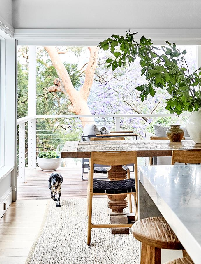 Glass doors between the dining area and verandah retract fully, effectively doubling the living space.