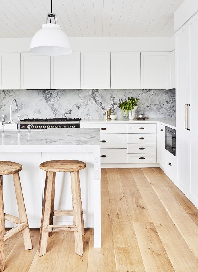Joinery by Captive Cabinet Making. French-oak flooring, D&D Hardwood Flooring. Wall-side benchtops in Caesarstone Organic White. Island benchtop and splashback in Elba marble from Central Coast Granite. Mixer taps, The English Tapware Company.