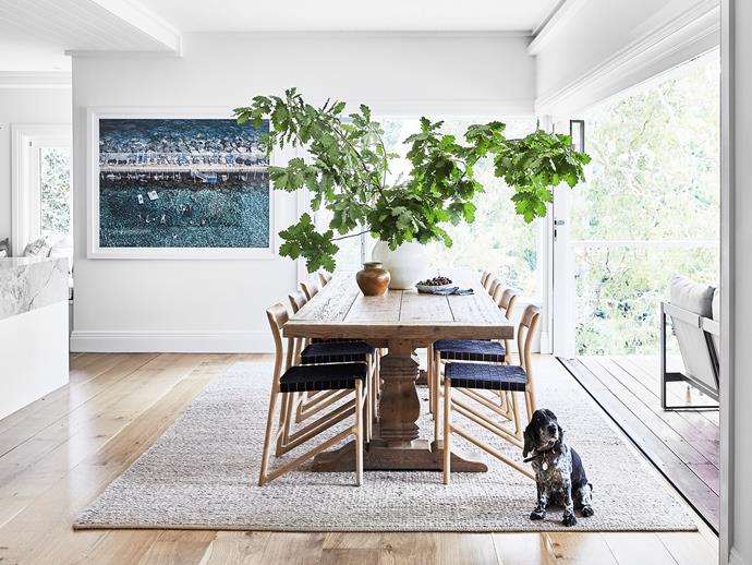 Dining table, Coco Republic. Dining chairs and Armadillo & Co rug, all Curious Grace. Photograph of Sorrento Beach by Stewart Cantor.
