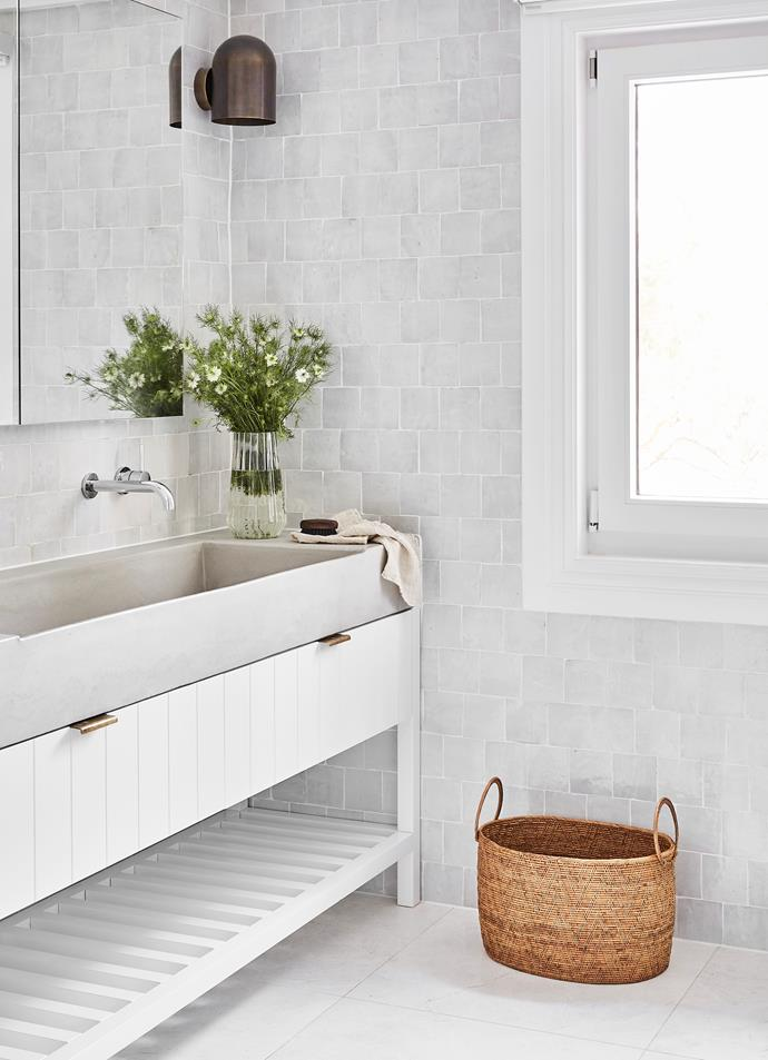 Crystal and Oliver wanted the bathrooms to have a luxury-hotel feel. Zellige natural clay tiles, Barefoot Living. Duomo Piccolo wall sconce, Nightworks Studio. Elba White marble tiles, SNB Stone. Custom trough sink by Concrete Studio.